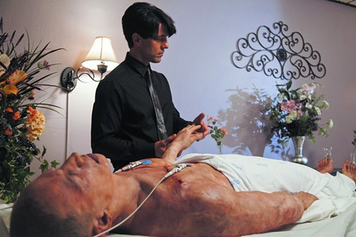 Criss Angel admires a corpse on Believe.
