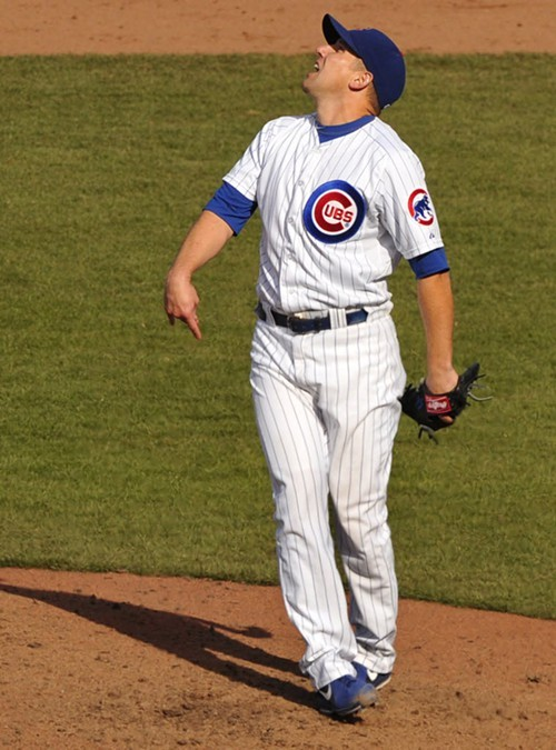Cubs reliever Shawn Camp watches Hunter Pences two-out homer tie the game in the ninth Sunday.