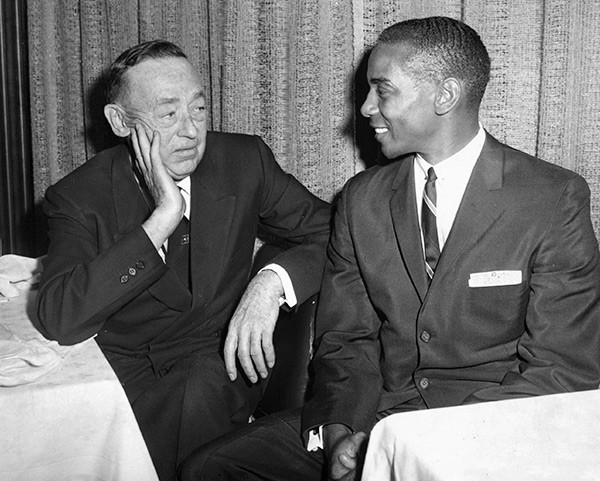 Cubs owner P.K. Wrigley and Ernie Banks, the team's first black player, chat at the team's annual luncheon in 1962. - SUN-TIMES PRINT COLLECTION
