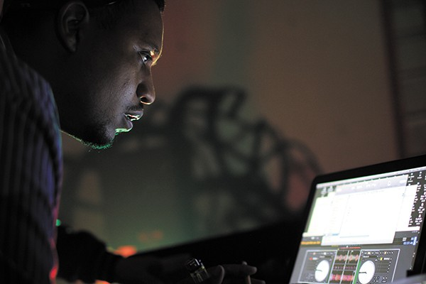 DJ Rashad hovers over his laptop at a Lit City Rave hosted by New York venue 285 Kent in fall 2012.