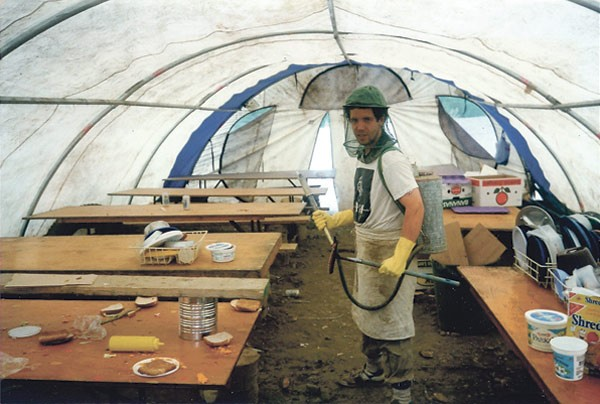 Doerksen in his youth in British Columbia, performing front-of-house duties with a firehose and squeegee