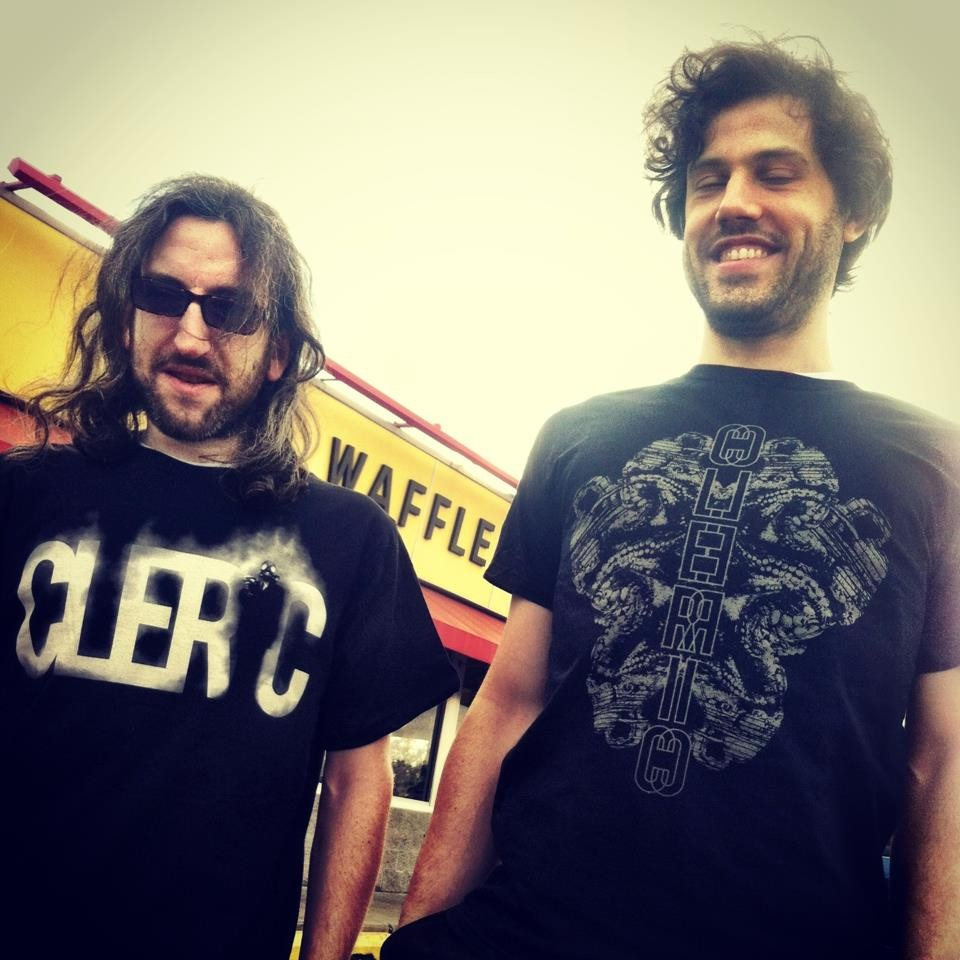Drummer Larry Kwartowitz and guitarist Matt Hollenberg model the new Cleric T-shirts.
