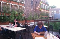 Eating in a rooftop garden at Homestead