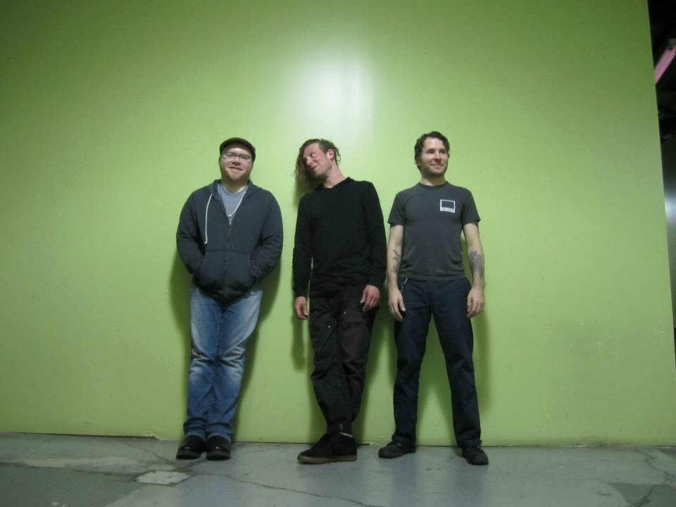 Electric Hawk: Guitarist Michael Burns, drummer Noah Leger, and bassist Graham McLachlan