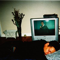"""Canadian hardcore band Single Mothers' photos from their trek through Detroit and Chicago """"Evan [Redsky, bassist] passed out while everyone else watches a Daniel Tosh standup special."""" Leor Galil"""