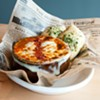 """Fascinating """"French kimchi soup"""" has a crusty layer of provolone protecting a spicy swamp of powerful kimchi and meaty slices of andouille sausage."""