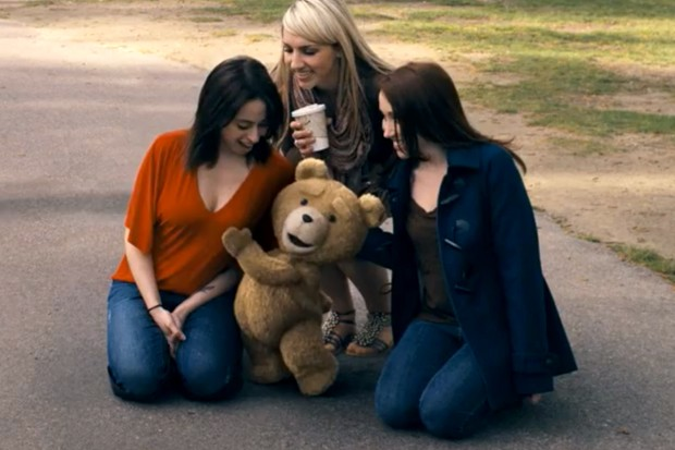 For once its the teddy bear doing the squeezing