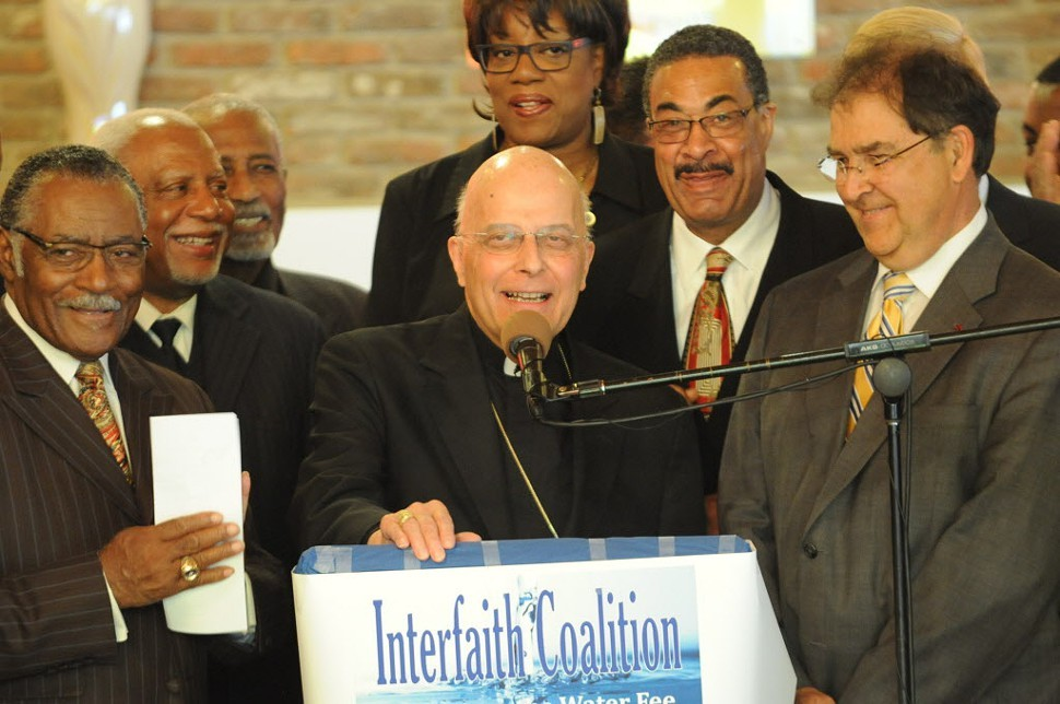 Francis Cardinal George speaking at the Interfaith Coalition to Restore the Water Fee Exemption press conference at the St. Paul Church of God in Christ