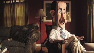 From the film, White wearing a Lyndon Johnson puppet head