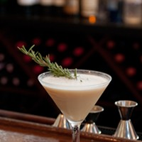 Mike Freeman makes his P'nut-Bourbon Julep Garnish with a sprig of rosemary. Andrea Bauer