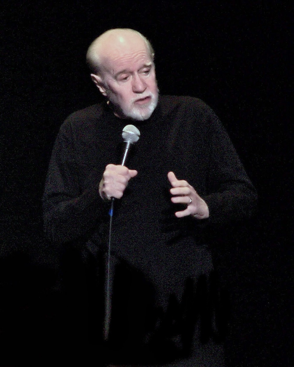 George Carlin: not a football fan, not during baseball season, anyway.