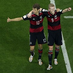 German players celebrate after scoring yet another goal in their World Cup rout of Brazil.