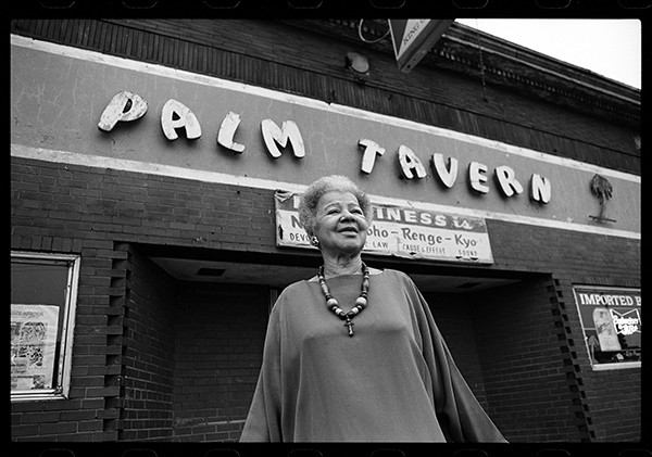 Gerri Oliver in front of the Palm Tavern in 2001, the year the city shut it down