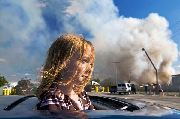 Girl at a junk yard fire in East Chicago - LLOYD DEGRANE