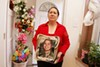 Gloria Barrios with a portrait of her daughter, Blanca Luna