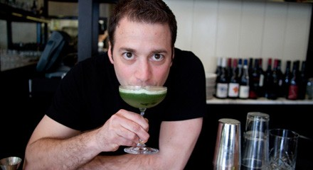 GT Fish & Oyster's Johnny Costello Jr. is nearly nose-deep in his cocktail, the Forager