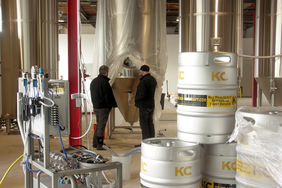 Gulley and Doug Hurst of Metropolitan Brewing contemplate the vortex. Thats a keg washer in the left foreground.