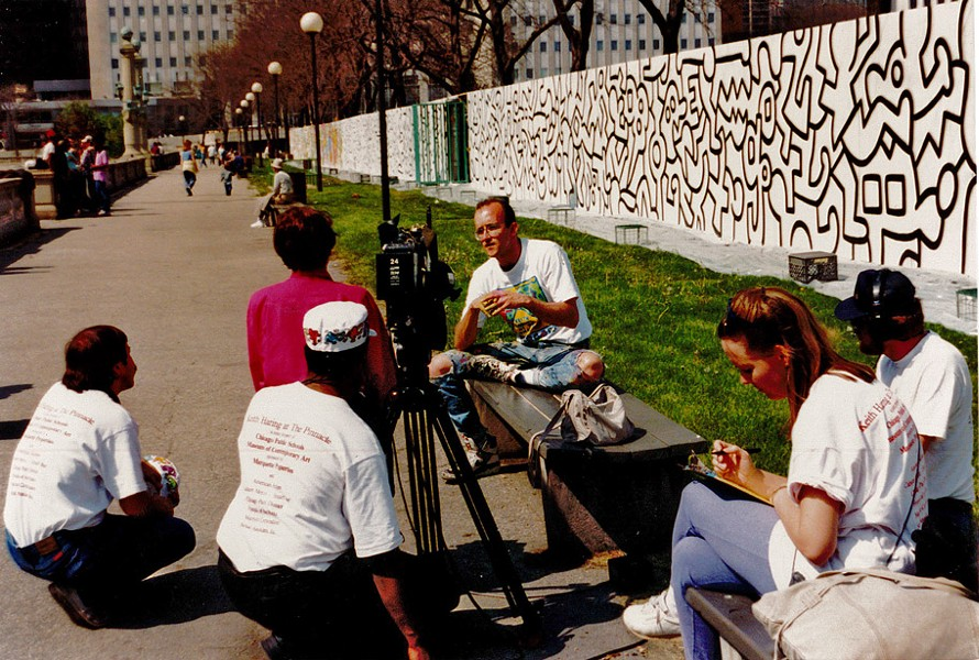 Haring is interviewed in front of the mural in progress. - MARCELINO Y. FAHD