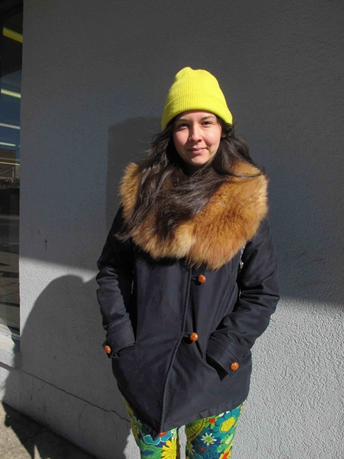 Her jackets fur collar adds interest and warmth to the look.