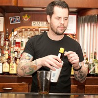 "Bradley Bolt of Bar DeVille makes the Blind of Eye In Bolt's words, ""build all ingredients in a mixing glass,"" beginning with three dashes of Angostura bitters. Andrea Bauer"