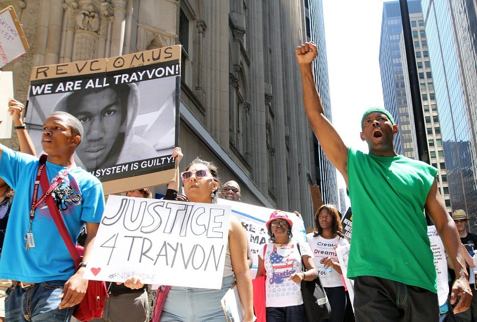 In downtown Chicago yesterday, demonstrators protested the acquittal of George Zimmerman.