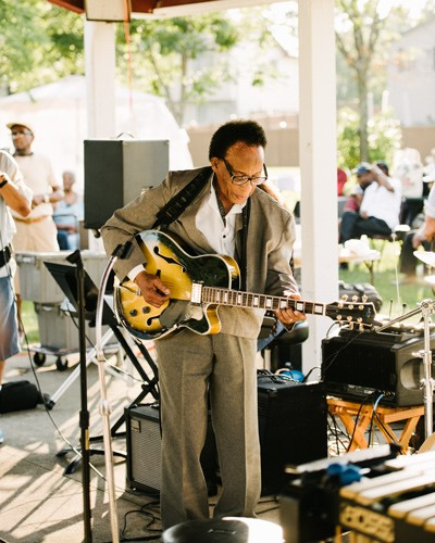 Jazz guitarist George Freeman, younger brother of late saxophonist Von, sits in at the Wright Gathering. - RYAN LOWRY