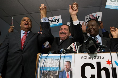 Jesus Garcia accepts the endorsement of Willie Wilson (right) this morning at the Chicago Baptist Institute. At left is Reverend Greg Seal Livingston, who managed Wilsons campaign.