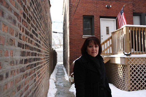 Juanita Irizarry, whos running for alderman in the 26th Ward, stands outside her childhood home in Logan Square.