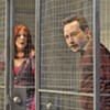 Kate Buddeke and Kevin Stark, caged, in <i>The North Plan</i> at Theater Wit.