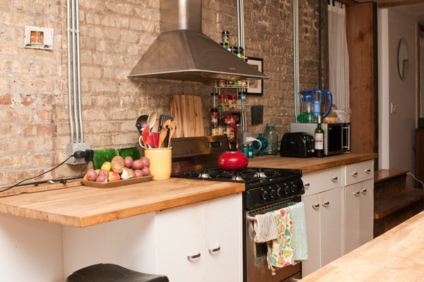 Kate's kitchen has wooden counter tops and cabinetry built from materials found at Rebuilding Exchange.