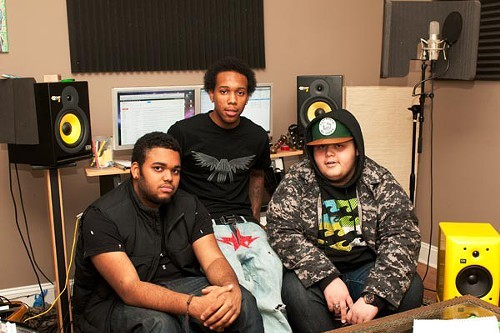 Kembe X (left) with Genesis Denton and Alex Wiley back in 2012