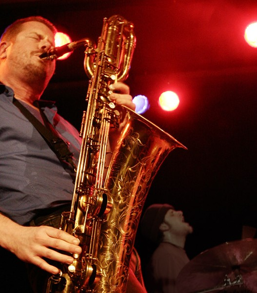 Ken Vandermark does his best to turn a baritone saxophone inside out. - JUAN-CARLOS HERNANDEZ