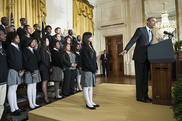 Kiara Molina and other members of the Harlem Children's Zone Promise Academy listen as President Obama speaks about poverty during an event at the White House on  January 9. - BRENDAN SMIALOWSKI/AFP/GETTY IMAGES