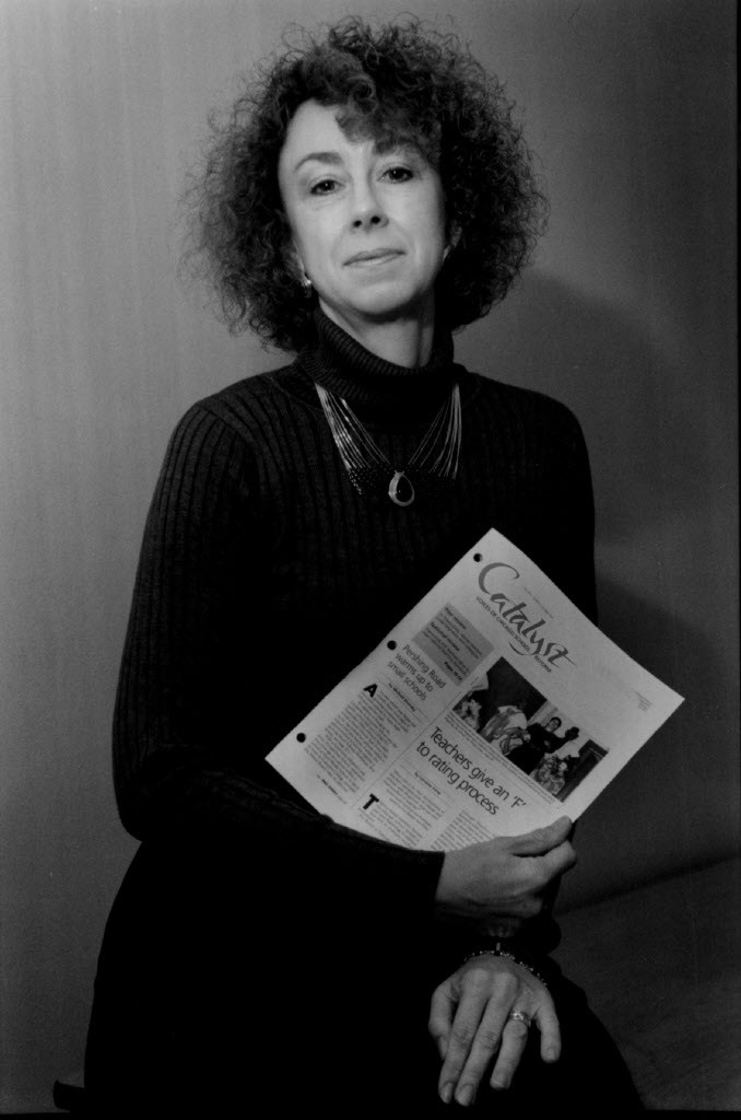 Linda Lenz holding a copy of Catalyst in 1994