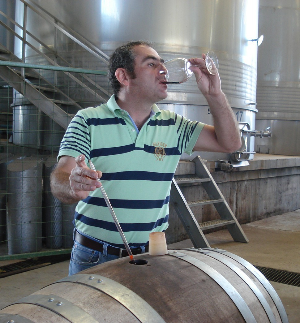 Mario Ravenna, tasting wine from the barrel