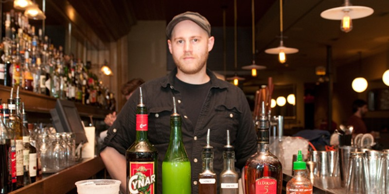 Step-by-step instructions for making a Barrelhouse Flat bartender's sriracha cocktail Mark Brinker with his ingredients: coconut cream, Cynar, lime juice, honey and ginger syrups, El Dorado 5 Year, sriracha, whole egg, and cinnamon Andrea Bauer