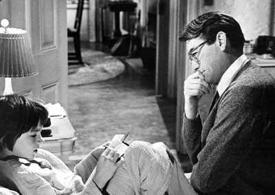 Mary Badham and Gregory Peck as Scout and Atticus Finch