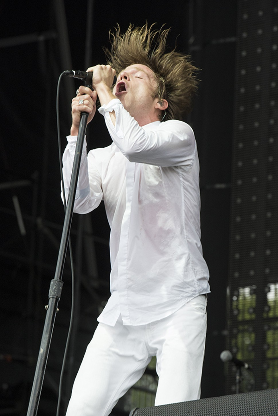 Matt Shultz from Cage the Elephant is about to ruin that outfit in the mud.