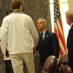 Mayor Emanuel shakes hands with one of the high school basketball players honored at a City Council meeting last April.