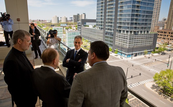 Mayor Rahm Emanuel and other officials eye the proposed site of DePaul's publicly subsidized basketball arena.