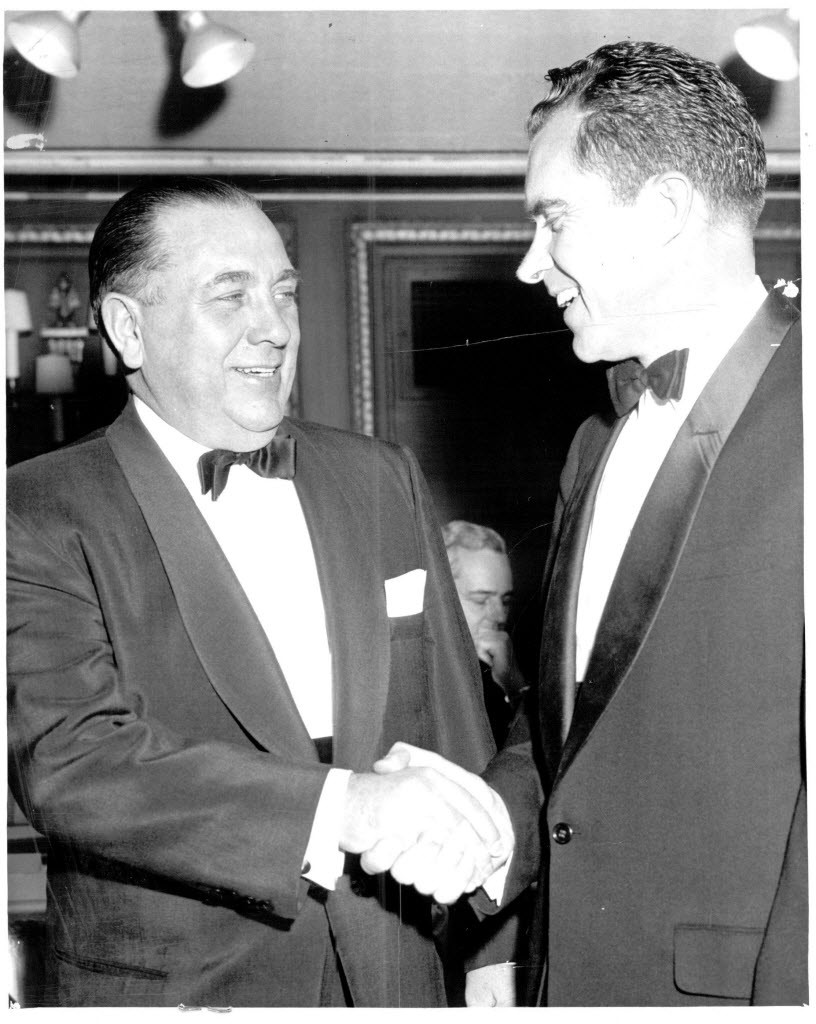 Mayor Richard J. Daley greets vice president Richard M. Nixon at the Palmer House in 1958, 11 years before Nixon became the most American of American presidents