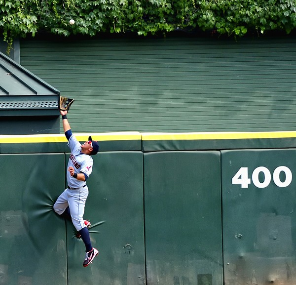 Michael Brantley Robs Alex Rios of a Home Run. US Cellular Field, May. By Paul Boucher - PAUL BOUCHER