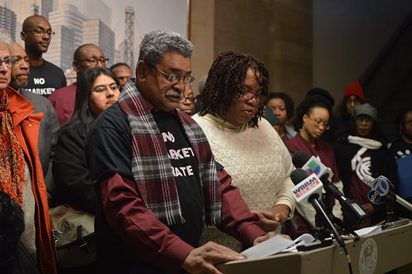 Miguel Suarez at City Hall in January, speaking out against the conversion of Lathrop Homes into a mixed-income development. - MAYA DUKMASOVA