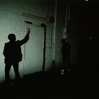 """Canadian hardcore band Single Mothers' photos from their trek through Detroit and Chicago """"Mike and Drew leave their marks behind a party store in Michigan."""" Leor Galil"""