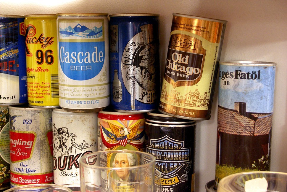 Mike Marszewski displays part of his vintage beer-can collection at Marias, but some of the rest lives at Marz.
