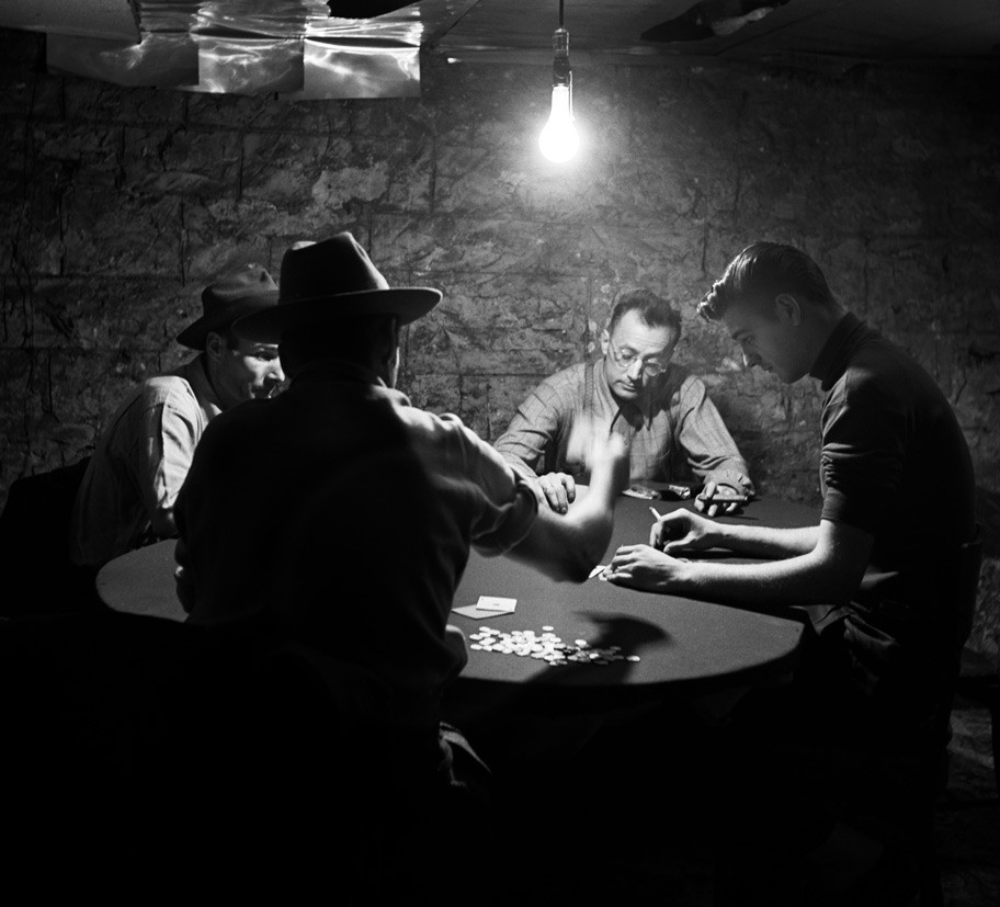 Nelson Algren playing cards with a group of acquaintances, including William Hackett, the original man with the golden arm. - ART SHAY