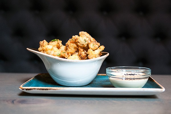 Nicely fried Parmesan-crusted cauliflower florets served with a blue cheese dipping sauce