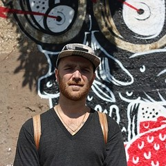 Nick Marzullo, co-owner of the artists' collective Pawn Works, wonders when it's going to get paid for work on murals in Pilsen.