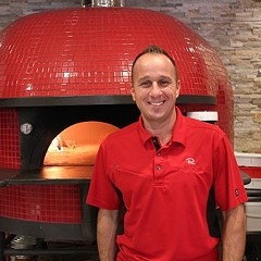 NIck Nitti in front of his 6000-lb. woodburning oven at Forno Rosso.