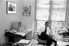 Obama in his University of Chicago law school office with a photo of Harold Washington and a Project Vote poster